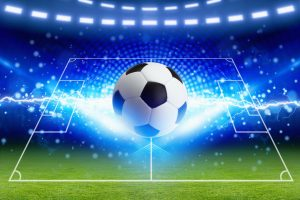 Abstract sports background - soccer ball, bright blue lightning, green football field with layout