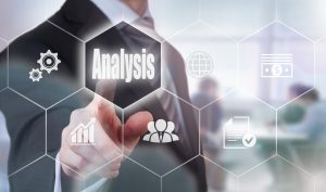 Businessman pressing an Analysis concept button.